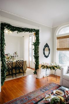 holiday garland in doorway and greenery wrap around drink trough.