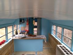 This is a 1993 International converted and registered as a motorhome. The bus starts right up. The bus is about 29′ in length but can be driven with a regular driver's license. (No commercial license necessary). The windows make it feel airy, bright and well-ventilated. I recently stripped and redid the walls and the floors…