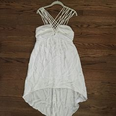 BCBGeneration white sundress White high-low sundress with front-cross straps // falls mid-thigh in the front // wrinkled because it has been in storage for several months (i will wash it before sending!) // viscose, nylon, and polyester // machine wash cold BCBG Dresses High Low