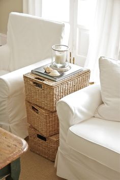 Using baskets for an end table -- might do this in my living room with dark brown baskets!