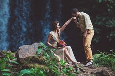 So much adoration captured in this wedding photo. And the waterfall!? Wow! Photos by Costa Vida Photography