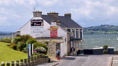 The bar has a fabulous setting on the sea front and enjoys panoramic views over Lough Swilly towards Inch Island and the Inishowen Peninsula. Donegal, Island, Mansions, House Styles, Dancing, Manor Houses, Villas, Islands, Mansion