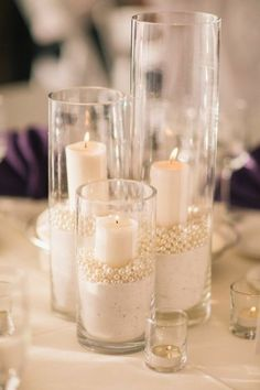 your votive candles in glass cylinders with sand and pearls for a nautical, romantic look! {Bayphoto Net Photography}Layer your votive candles in glass cylinders with sand and pearls for a nautical, romantic look! Votive Candles In Glass, Candle Centerpieces, Pearl Wedding Centerpieces, Pearl Centerpiece, Centerpiece Ideas, Vintage Centerpieces, Centerpiece Flowers, Graduation Centerpiece, Quinceanera Centerpieces