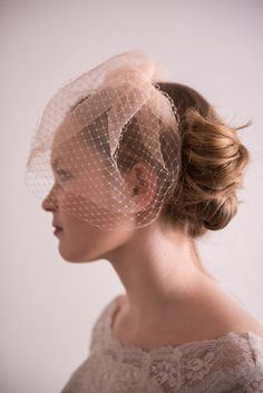 A few extra details about this bridal headpiece:  · 1 full birdcage and tulle veil, douple layerd · White, ivory and peach available · Other colours