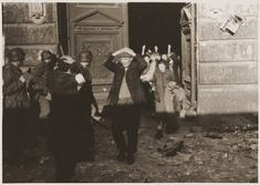 Jews surrender to the SS soldiers at the end of the Warsaw Ghetto Uprising