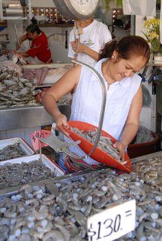 Woman selling fish in a Puerto Vallarta, Mexico Market
