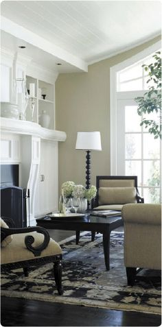 Love the chairs and neutral living room colors.