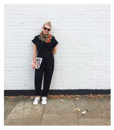 Perfect your effortless dressing by investing in a jumpsuit, our E-commerce director nails the trend in this ASOS black number. Styled with trainers for comfort and finished off with a leopard print scarf, it's the perfect daytime look.