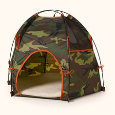 Wagwear Tee Pee Hound Lounge (aka dog tent) is perfect for your camping companion. If only our dogs were quiet enough...