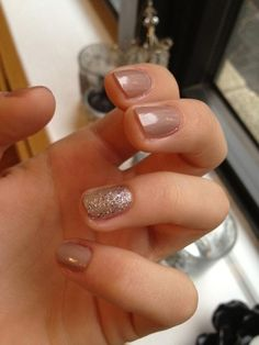 Love the neutral color with the one nail with a bit of flare! I really love having one nail different. So cute.