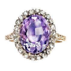 Lee Valley is a remarkable Victorian era statement ring, made from 18k yellow gold and silver featuring an exquisite oval amethyst weighing approximately 5.00cts and surrounded by twenty-eight beautiful rose and single cut diamonds (total approximate weight of 0.85ct) that create a halo and line Lee Valley's shoulders and is further enhanced by filigree throughout the basket.