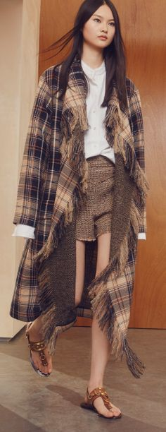 Shop now. Chloé Fringed Wool- And Cotton-Blend Coat. Chloé's pre-spring 2017 collection takes its cue from laid-back Californian vibes and the artisanal textiles of traditional South American dress. Both are combined to cool effect in this blanket style coat, crafted from tonal brown tartan with pops of orange and navy. Crafted from a wool and cotton blend, the raw-edged design drapes flatteringly. Emphasise your waist with the optional leather belt. Has flapped patch pockets. So easy.