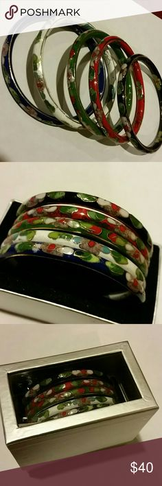 "Vintage enamel cloisonne bangle set of 5 Multicolored enamel bangles, they are not all exactly the same size. New, never worn, they've been sitting in a box in storage.  I *think* I bought them at kohl's :) complete with the original gift box. Too big for my wrists.  Very pretty jewel tones. Smallest on is a little under 2.75"" (inner diameter), largest is right at 2.75"" diameter. All are approx 3/8"" thick. Jewelry Bracelets"