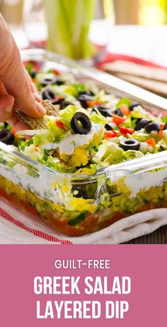 Greek Salad Layered Dip Recipe is a fresh healthy appetizer made with lettuce, tomatoes, feta cheese, olives and Greek yogurt. Serve with pita chips or celery sticks. #cleaneating #healthy #recipe #recipes #potluck #lowcarb #keto