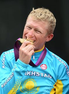 JULY 28: Gold medallist Alexandr Vinokurov of Kazakhstan celebrates during the Victory Ceremony for the Men's Road Race Road Cycling on Day 1 of the London 2012 Olympic Games on July 28, 2012 in London, England. (Photo by Jamie Squire/Getty Images)