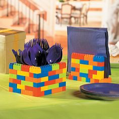 If you're throwing a Lego-inspired birthday party, our building block DIY utensil and napkin holders are for you! So simple to make and your little party guests will think they're so awesome!