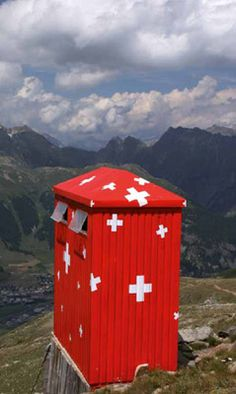 Even an outhouse seems more attractive with a Swiss flag pattern...