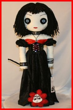 She's 22 inches tall and completely hand stitched!