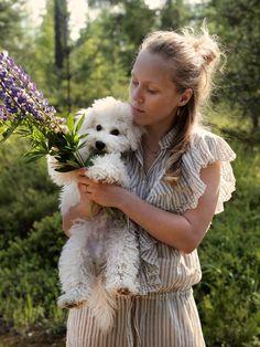 Girl, dog and flower.