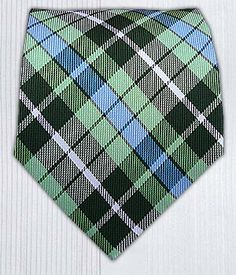 "Totally Tartan - Greens (#12213). A bold and fun plaid design in hunter green, apple and light blue keeps you preppy and still in style. A great tie for a navy suit. Handmade of 100% Woven Silk. $15 for Regular Length (58"" x 3 ½""), 20.00 for Extra Length (63"" x 3 ¾"")."