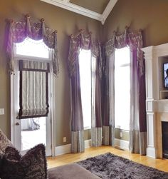 Our Granada #valance over #Panels and #romanshades  #windowtreatments www.LadyDiannes.com