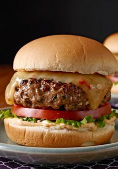 Gourmet Chipotle Burgers —  Ground beef, chipotle peppers, cilantro and garlic make the ultimate burger patties. Just add cheese and toppings to finish the gourmet experience.