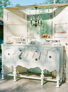 Great idea for a cake table except French doors on the sides and a cuter chandy