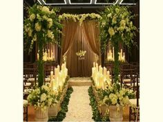 "Use of pipe and drapes to create  the ""arch""  Use of decorated pipe for aisle decoration"
