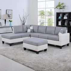 This beautiful traditional yet modern large two tone white and gray sectional sofa features white bonded leather upholstery on hardwood frame and cushions are covered with a soft linen fabric. This sectional sofa also features a chaise lounge enabling to position chaise on either end to better fit your space and includes 2 matching accent pillows.