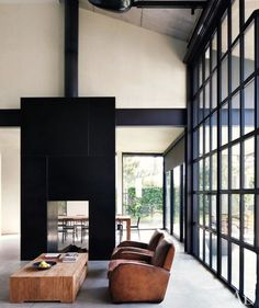 minimalist, tall ceiling, floor-to-ceiling windows, lots of natural lighting, wood, tinge of industrial