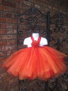 Our tutu dress in but in orange / lime green combo