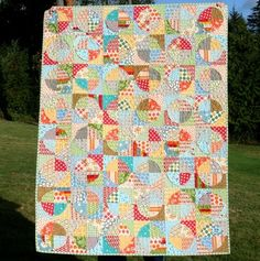 Love this. Great site: http://www.cluckclucksew.com/2009/12/raw-edge-circle-quilt-tutorial.html