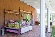 Actress Jane Fonda created majestic outdoor seating for the terrace of her New Mexico ranch with a brass bed and mesmerizing Pakistani fabrics.