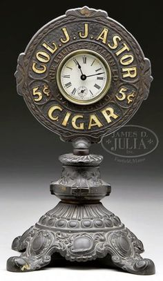 "A ""Col JJ Astor 5 Cent Cigar The Louis Heitmann Co. Dayton, O""  elaborate Victorian cast iron advertising table clock, with dial marked Waterbury Clock Company"
