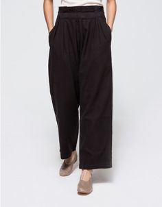 From Black Crane, a pair of sleek, soft pull-on pleated pants in Black. Features elasticated waistband, front waist pleats, on seam side pockets, full length leg, slightly tapered leg and relaxed fit.  •Pull-on pleated pants in Black •Elastic waistba
