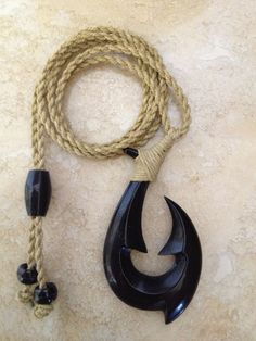 real hawaiian fish hook carved from buffalo horn for m and w.comes with 1year W