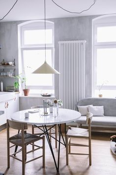 """Berlin based blogger team """"our food stories"""" feature Børge Mogensen's chair J39 in their kitchen."""