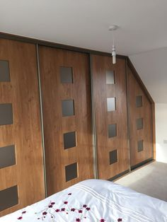 Fitted wardrobe into the eaves with Winchester oak & matelac bronze inserts. Below is a link to our online calculator to see how much your bespoke made to measure wardrobe will cost http://www.foxwardrobes.co.uk/instant-online-estimator/