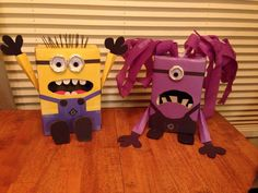 Minion Valentines day box made from shoe boxes with construction paper, toilet paper roll and some wiggle eyes. Total cost $.25 for eyes and all other materials where found around the house.