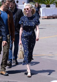 Chic: The mid-length frock was emblazoned with a pretty dandelion print and boasted a number of flirty frills for some added pizzazz