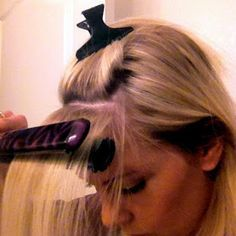 Use a flat iron to tame your cowlick and get perfect side-swept bangs.