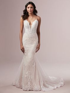 This delicate sheath wedding dress has an overlay of Chantilly lace with lace motifs. Its plunging illusion V-neckline, illusion lace back, and beaded spaghetti straps complete the look. Finished with covered buttons over zipper closure. Size 12 Wedding Dress, How To Dress For A Wedding, Perfect Wedding Dress, Cheap Wedding Dress, Designer Wedding Dresses, Bridal Dresses, Nude Gown, Blush Gown, Maggie Sottero Wedding Dresses