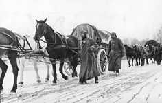 German infantrymen in heavy winter gear march next to horse-drawn vehicles as they pass through a district near Moscow, in November 1941. Winter conditions strained an already thin supply line, and forced Germany to halt its advance - leaving soldiers exposed to the elements and Soviet counterattacks, resulting in heavy casualties and a serious loss of momentum in the war.