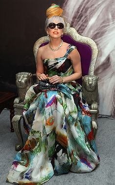Lady Gaga goes glam in a colorful watercolor print asymetrical gown during a press conference before a 2011 performance in New Delhi, India.