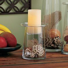 Modern blown glass vessel offers clean, simple lines to complement any décor. Fill the base with dried botanicals or seasonal decorations and place a candle in the removable insert for a finishing touch. Base can also be used as vase. Food safe. Starting at $35 &Up