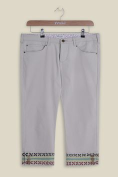 In a Mistral favourite style, our Embroidered Hem Trousers are the perfect wardrobe addition for the upcoming warmer months. The lightweight cropped trousers bring glamour through their embroidered split cuffed bottoms, secured with three buttons. Pair with one of our vests for a casual look. Also available in Asphalt.