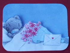 small card, flowers and card on bed. TTx