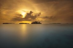 We went to one of the 1000 islands off of Jakarta's coast, Pulau Macan or Tiger Island, a very small island and this is the view from the pier at 5 o'clock  in the morning, the island was still sleeping and the sun was hiding behind the clouds as she rose to light the sky on fire. Time to go for a swim...