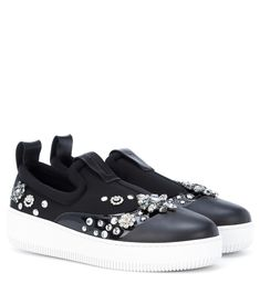 McQ Alexander McQueen - Netil embellished sneakers - McQ Alexander McQueen's Netil sneakers have been crafted from neoprene with a patent panel and smooth leather toecap.  A scattering of studs and crystals brings tough-luxe embellishment, while the chunky rubber sole adds durability and stark colour contrast. seen @ www.mytheresa.com