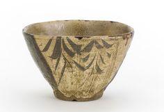 Seto ware tea bowl in Oribe style, 19th century. Edo period. Stoneware with iron decoration under clear glaze, copper-green ash glaze, and iron wash. H: 8.9 W: 12.7 D: 12.7 cm. Seto, Japan.